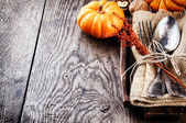 Seasonal table setting with small pumpkins — Stock Photo