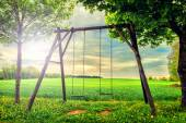 Lonely swing at summer sunset — Stock Photo