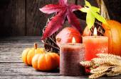 Autumn still-life with pumpkins and candles — Stock Photo