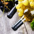 Bottles of wine with fresh grape — Stock Photo #52428723