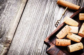Bunch of wine corks and corkscrew — Stock Photo