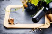 Frame with wine bottle and grape — Stok fotoğraf