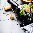 Bottle of red wine with fresh grape — Stock Photo #52855973