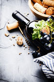 Bottle of red wine with fresh grape — Stock Photo