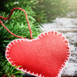 Vintage red heart in Christmas setting — Stock Photo #53804345