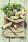 Wine corks and corkscrew in rustic setting — Stock Photo