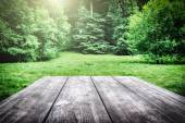 Wooden picnic table in forest — Stock Photo