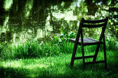 Lonely old chair in garden — Stock Photo