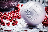 Christmas ornaments in festive setting — Photo