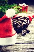 Santa's hat in Christmas setting — Stock Photo