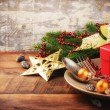 Christmas table setting with gift — Stock Photo #57296423