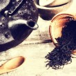 Closeup of black tea and teapot — Stock Photo #57296545