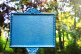 Vintage styled sign board in autumn park — Stock Photo
