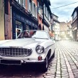 Retro car in old city street — Stock Photo #58245363
