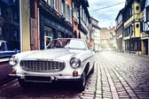 Retro car in old city street — Stock Photo