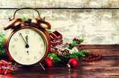 Christmas decorations with vintage alarm clock — Stock Photo