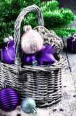 Christmas decorations in purple tone — Stock Photo