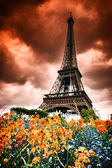 Eiffel tower with abstract red sky — Stock Photo