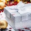 Christmas ornaments and present in silver  box — Stock Photo #61313263