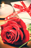 St Valentine's setting with rose and love letter — Stock Photo