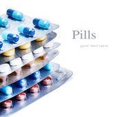 Stack of multicolor medicine pills — Stock Photo