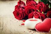 St Valentine's setting with bouquet of red roses — Stock Photo