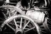Old wooden barrels and broken wheels — Stock Photo
