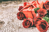 Valentine's setting with bouquet of red roses — Stock Photo