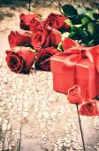 Valentine's setting with red roses — Stock Photo
