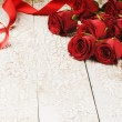 Bouquet of red roses on grunge background — Stock Photo #63035403