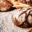 Baked bread in rustic setting — Stock Photo #63035679