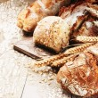 Freshly baked bread in rustic setting — Stock Photo #63035687
