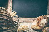 Baked bread in wicker basket with copyspace — Stock Photo