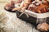 Baked bread in wicker basket — Stock Photo