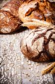 Baked bread in rustic setting — Stock Photo