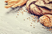 Freshly baked bread in rustic setting — Stock Photo