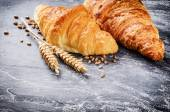 Breakfast setting with fresh croissants — Stock Photo