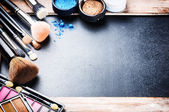 Various makeup products with copyspace — Stock Photo