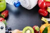Dumbbells, towel and fresh fruits — Стоковое фото