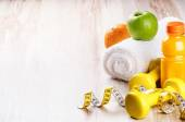 Fitness concept with dumbbells and fresh fruits — Photo