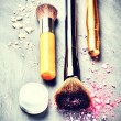 Постер, плакат: Makeup brushes and makeup products