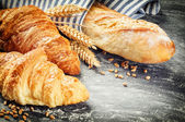 Baked baguette and croissants — Stock Photo