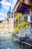 Wooden benches in european town — Stock Photo