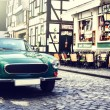 Retro car parked in city street — Stock Photo #70982651