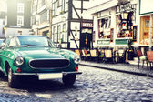 Retro car parked in city street — Stock Photo