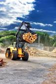 Forklift truck hauling logs at sawmill — Stock Photo