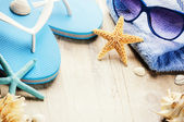 Holiday setting with flip flops — Stock Photo