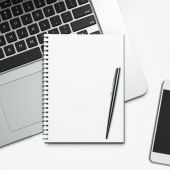 Blank notepad and laptop — Stock Photo