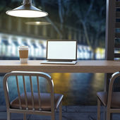 Laptop on cafe table — Stock Photo