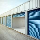 Empty storage unit with opened door — Stock Photo